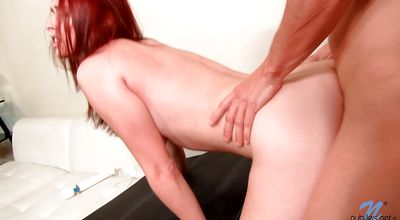 Sultry redhead woman Melody Jordan blows her buddy before fucking him